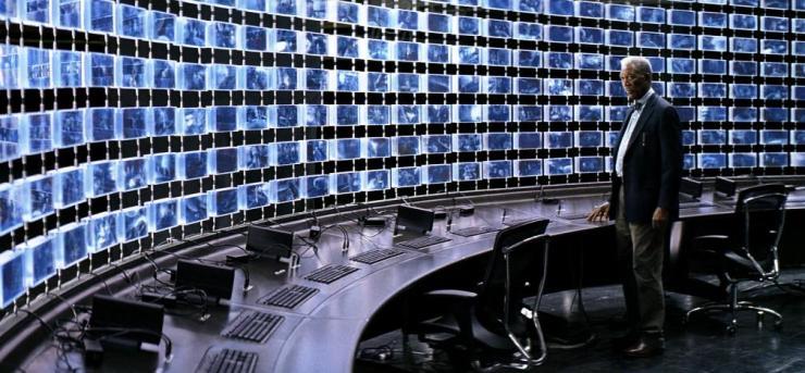 Lucius Fox monitors surveillance of Gotham City in The Dark Knight