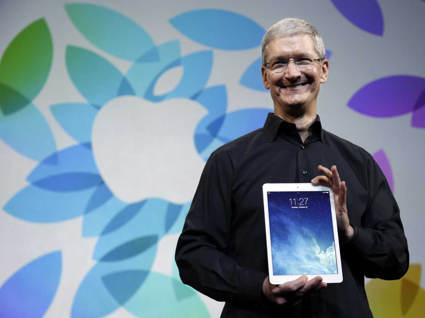Tim Cook holds iPad Air