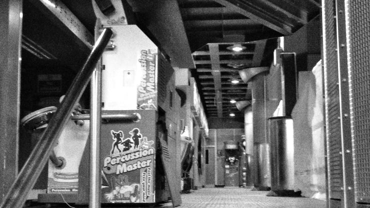 A single hallway remains, containing the unsold remains of Funland's arcade