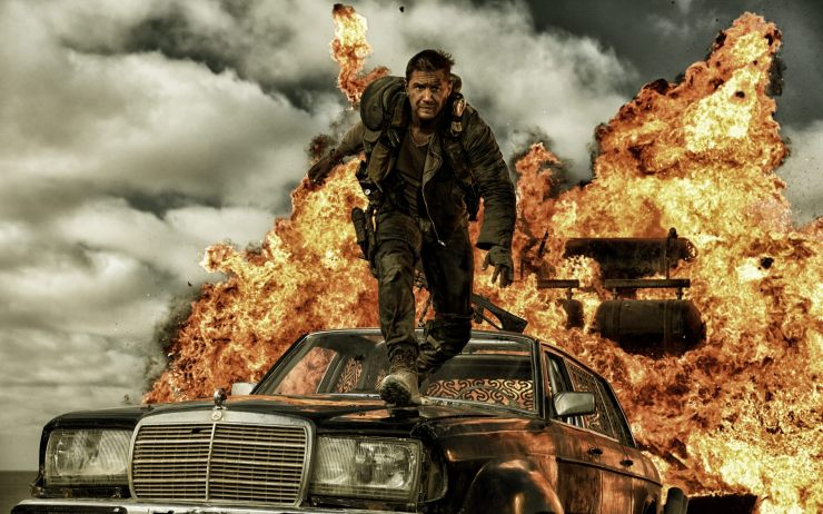 Max leaps from an explosion in Mad Max: Fury Road